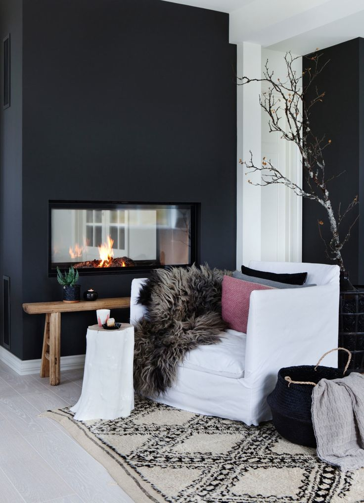Double sided fireplace - black wall