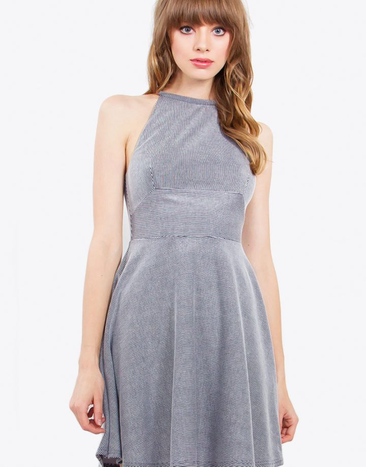 – Knit stripe dress with a halter neckline – Partially lined – Invisible zipper closure on back – Color: Navy/White  Size + Fit – Model is wearing size S – Measurements taken from size S – Length: 33″ – Chest: 31″ – Waist: 26″