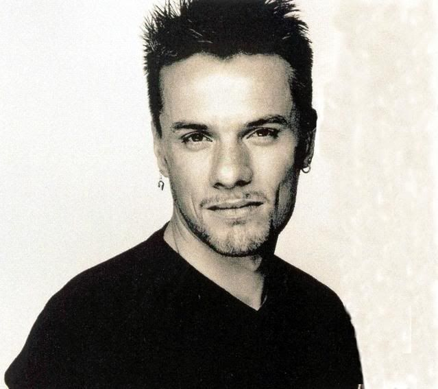 Larry Mullen Jr, the drummer from the band U2...my all time favorite, earrings and all.