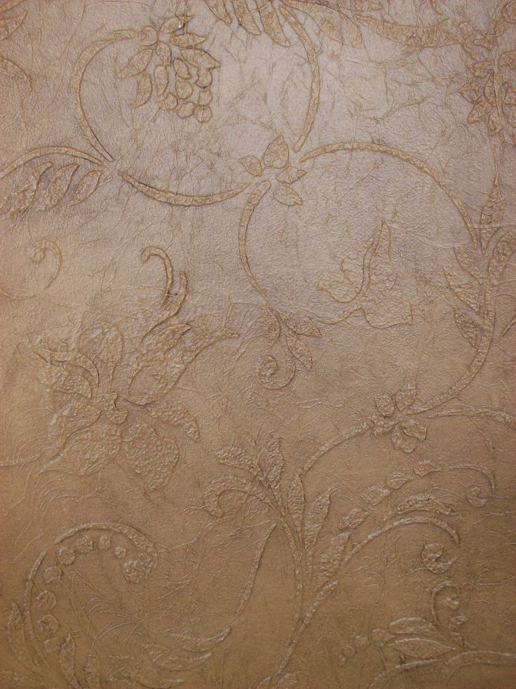 decorative wall treatment with tissue paper and plastered stencil overlay