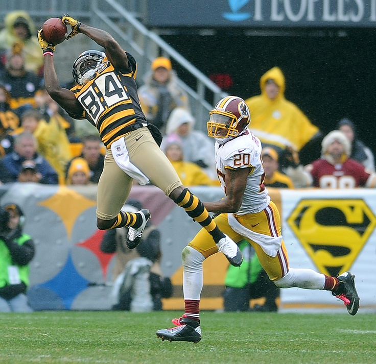 OCT. 28, 2012 — Steelers receiver Antonio Brown catches a pass over Washington's Cedric Griffin during the second quarter at Heinz Field. The Steelers won, 27-12. For a game recap, visit: http://triblive.com/sports/steelers/2820485-85/griffin-steelers-pass-redskins-yard-yards-game-defense-roethlisberger-ball#axzz2AvUOxc7K  Photo by Christopher Horner  |  Tribune-Review