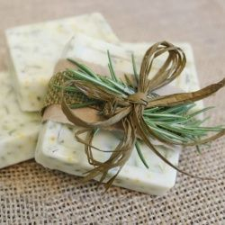 Rosemary and orange zest soap wrapped with rosemary sprig, could add dried orange slice