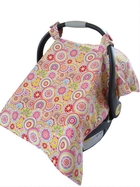 Personalized Infant Car Seat cover/ Car seat by PreciousBabyAttire on Etsy. Pick your own fabric and colors!  Infant Car seat cover makes the perfect gift for new moms. The Car seat tent design is not only trendy but a practical way of protecting your little one from strangers, germs, light and weather. Easy to install and remove velcro tabs on the top allow for it to double as a blanket, play mat or nursing cover. This cover fits most standard sized infant car seats.