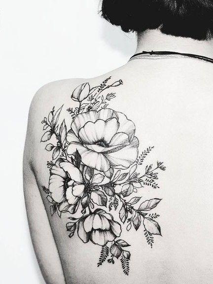 Intricate back flower tattoo. Click to discover more Sensational Flower Tattoos.