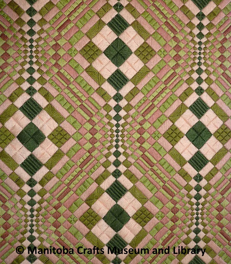 """Detail: Artist: Helen Russell Bargello panel 49cm x49cm; mounted on a 59cmx 59cm masonite panel, covered with green velveteen. Hangs diagonally. OP Art style, alternating colours and sizes of squares create a round """"bubbling"""" effect."""