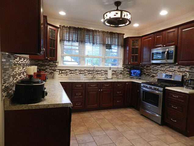 """""""At first I was afraid to order kitchen cabinets online but in the end, everything was great! My husband and I ordered the Pacifica cabinets in the RTA version and put them together ourselves. The cabinet installer was impressed with the all plywood construction of the cabinets and we saved thousands since we did everything on our own. Thank you Kitchen Cabinet Kings!"""" ~ Laurie Llynard 