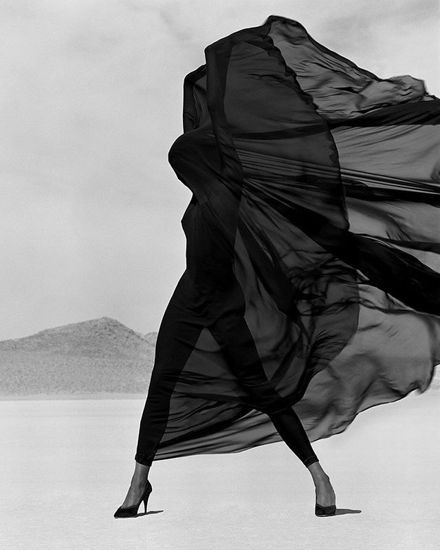 Throwback Thursday | Supermodel Naomi Campbell (@iamnaomicampbell) clad in a Versace Veiled Dreas photographed by Herb Ritts at the El Mirage dry lake, 1990.