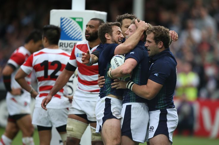 FINE FOR FINN: Greig Laidlaw is first to congratulated Finn Russell for scoring Scotland's fifth try in the defeat of surprise team Japan