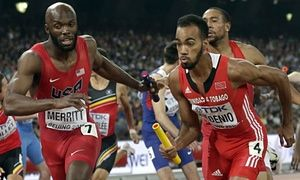 United States' Lashawn Merritt, left, takes the baton to anchor his team to the gold medal in the men's 4x400m relay final