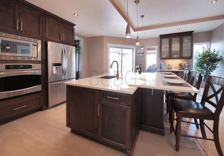 Transitional kitchen style with maple cabinet.