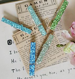 glittered clothespins for hanging art work or clipping papers together..just love these colors, too...greens and blues