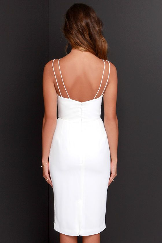 My, my, my! We have never laid eyes on a dress quite as lovely as the Keepsake Skinny Love Ivory Midi Dress! Skinny double spaghetti straps top this poly-blend dress, which boasts a layered neckline with a chic zigzag effect, enhanced by darted seams and a fitted waist. A midi length skirt creates a sleek finish ending with a kick pleat at back. Hidden back zipper with clasp. Fully lined. Self: 100% Polyester. Lining: 97% Polyester, 3% Spandex. Machine Wash Cold.