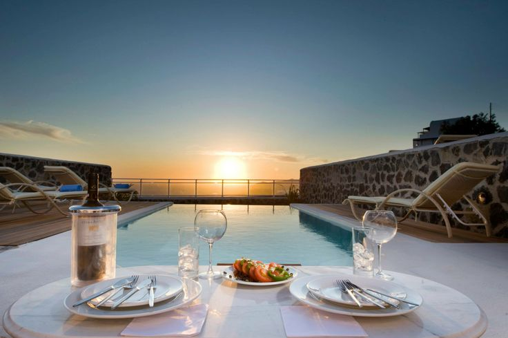 Enjoy your drink by the pool at #Santorini watching the beautiful #sunset view...