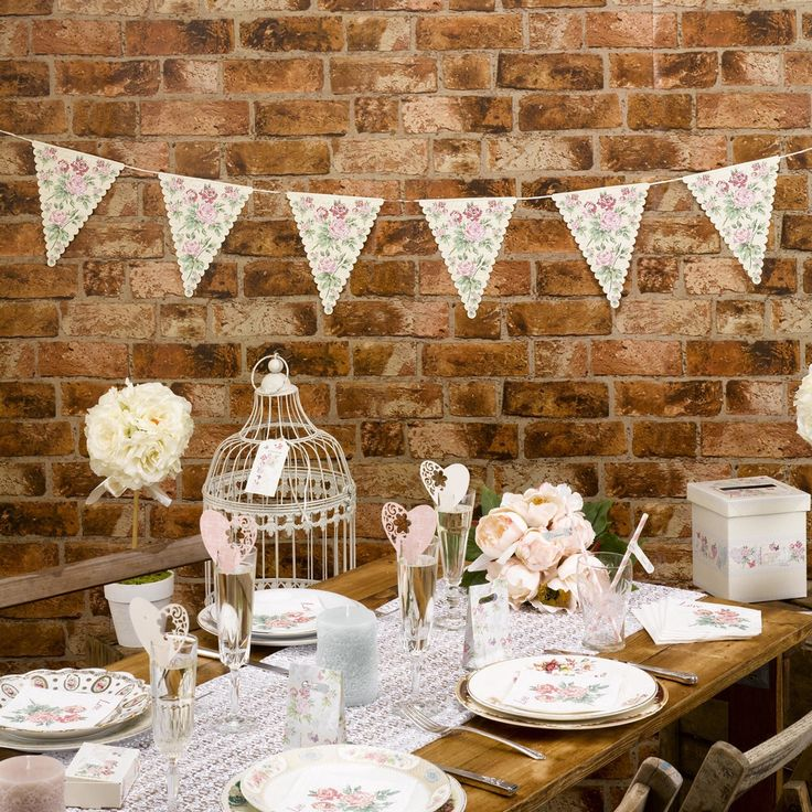 Vintage floral mini bunting perfect for a vintage wedding or celebration.  12 individual flags, this pretty bunting spells out 'Just Married' and includes a central flag featuring flowers, butterflies, hearts and doves. With a delicate scalloped edge and background inspired by old love letters, this lovely bunting can be used to dress walls, tables, trees or other areas of your wedding venue, either indoors or out.  Bunting measures 1 metre in length.