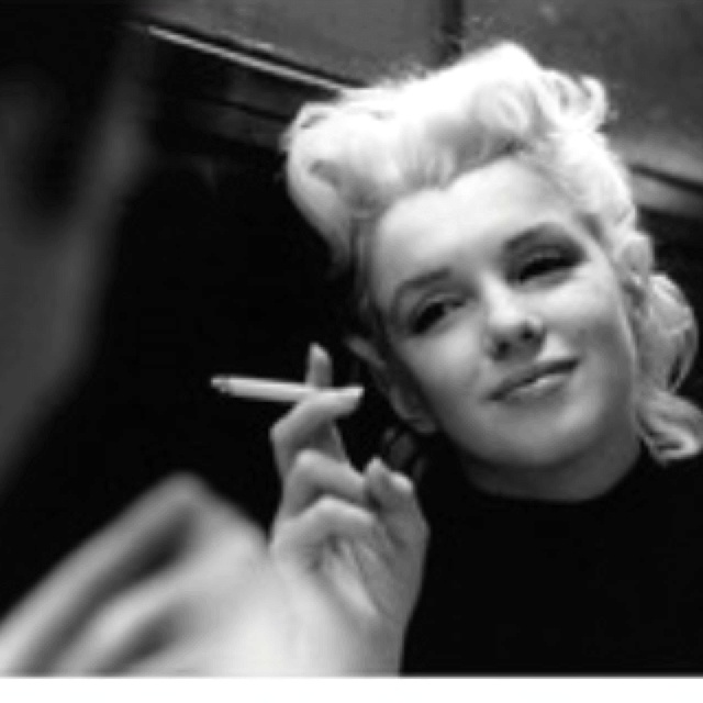 Marilyn relaxes in a restaurant, 1955