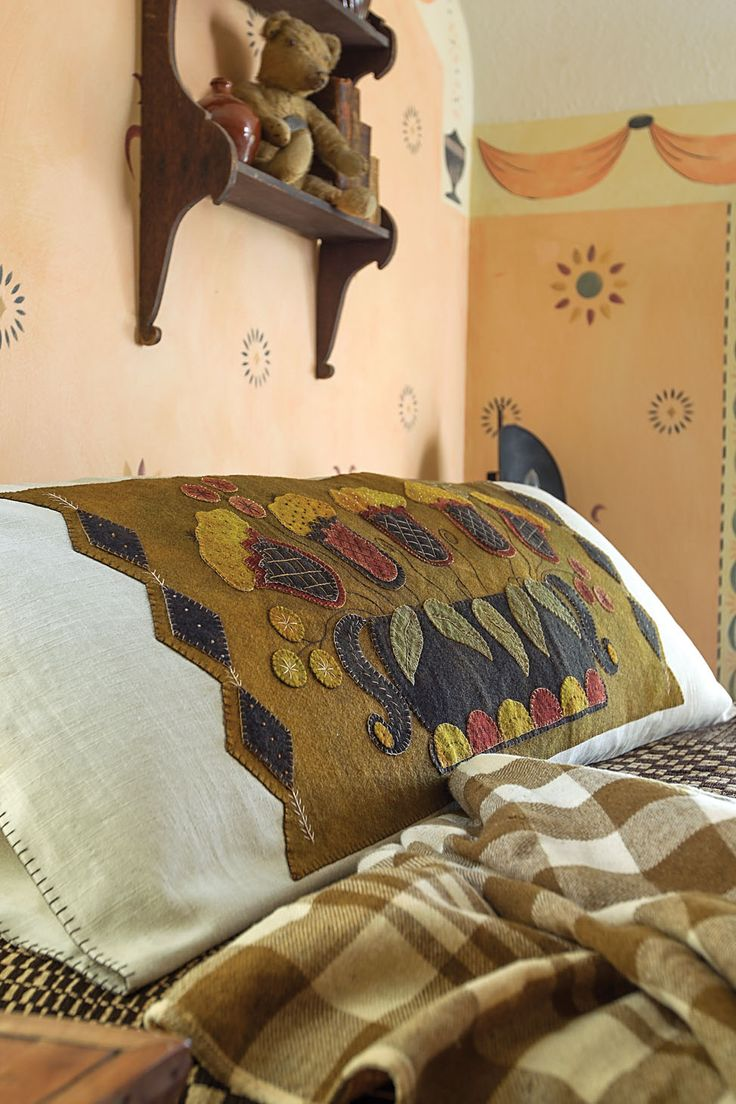 Stitch this bolster cover from Rebekah L. Smith's book, Seasons of Wool Applique Folk Art. Kits now available for pre-order!