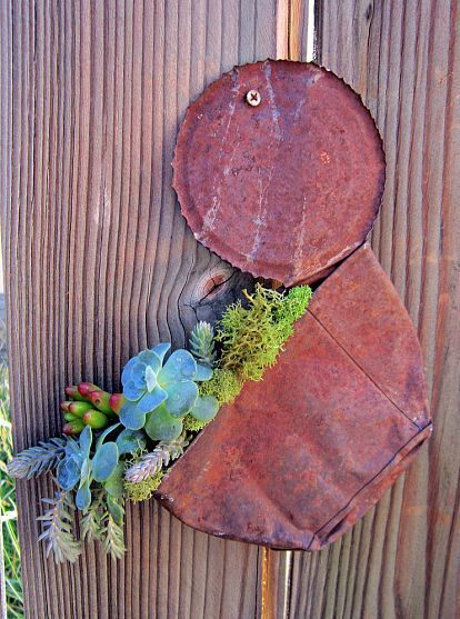 Two of my favorite things; rusty junk, and succulents.  This is indeed a match made in heaven, and so cute!