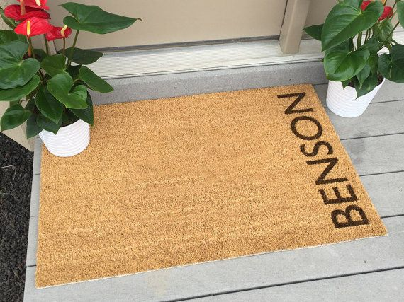 Custom Mats - Benson Style - Welcome Mat  Our Benson style door mat features our unique design that is very sleek and modern... guests will definitely notice! This door mat makes a perfect gift for weddings, showers, housewarmings, and even business clients. These outdoor doormats measure 35 by 23 inches. The bottom surface has a rubberized backing to keep them in place. They are cleaned by easily shaking out or vacuuming. ORDERING INSTRUCTIONS: Include the last name in the Note to Seller…
