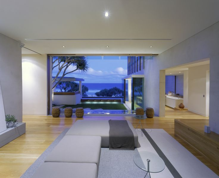 Sunrise Beach House / Wilson Architects This is a house of quietly relaxed luxury which overlooks the broad expanse of Sunrise Beach   /#beachhouse #queensland #beachview #pond #couch livingroom #architecture #interior design