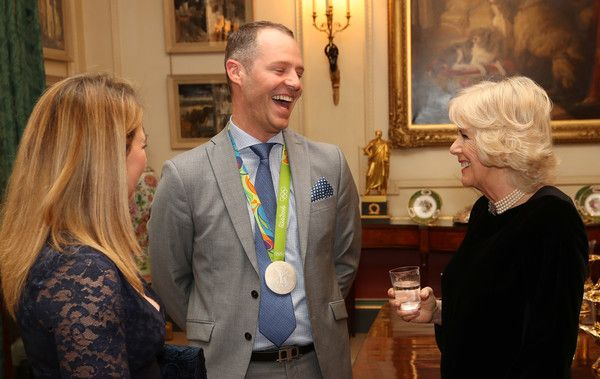 Camilla, Duchess of Cornwall (R) with equestrians Kitty King (L) and Spencer Wilton during a reception for the British Equestrian teams who took part in the 2016 Olympic and Paralympic games at Clarence House on January 24, 2017 in London, England.