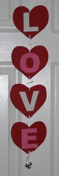 Love Doorhanger --- all you need is construction paper, glue, string and some bells if you want them. this would actually be super cute hanging in a window. :)