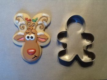 Upside down Gingerbread Man Cookie Cutter = Christmas Reindeer Cookie.  How cute!