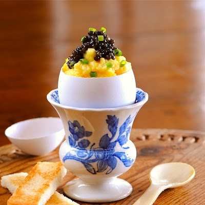 creamy eggs topped with Russian caviar tucked into a perfect little egg cup...  one of my all time favorite savory treats.    so simple, so delicious, so delicate and SOOOO EASY !..