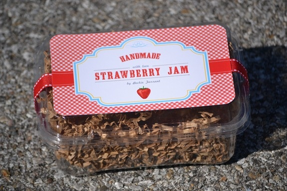 Supplies:  Strawberry Jam Printable - corner rounder punch - scissors or paper cutter - Double sided adhesive  ribbon-brown craft paper shreds - plastic strawberry container - 2 Cans strawberry jam in half-pint jars-one 1 pint jar - Designed by Louisa at Flipawoo