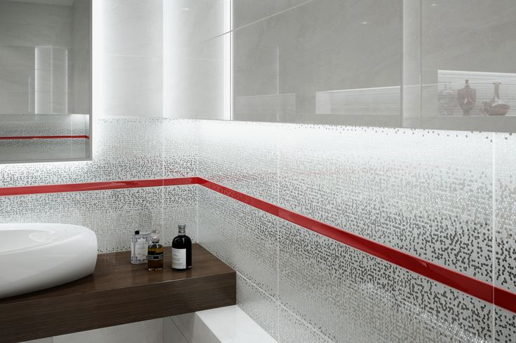 czerwone dodatki, błyszcząca łazienka, biało-czarna, geometria, lustrzany efekt, płytki łazienkowe - Mirror 25x75 - Opoczno - lustrzany efekt uzyskany został dzięki granilii na płytkach. Połyskujące elementy oraz czerwona listwa szklana nadają łazience niesamowitego szyku.