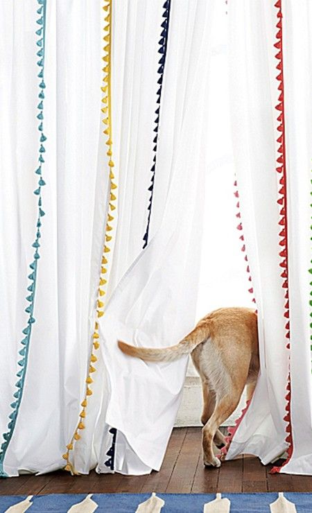 pompom edged curtains + a puppy tail = great accessories!