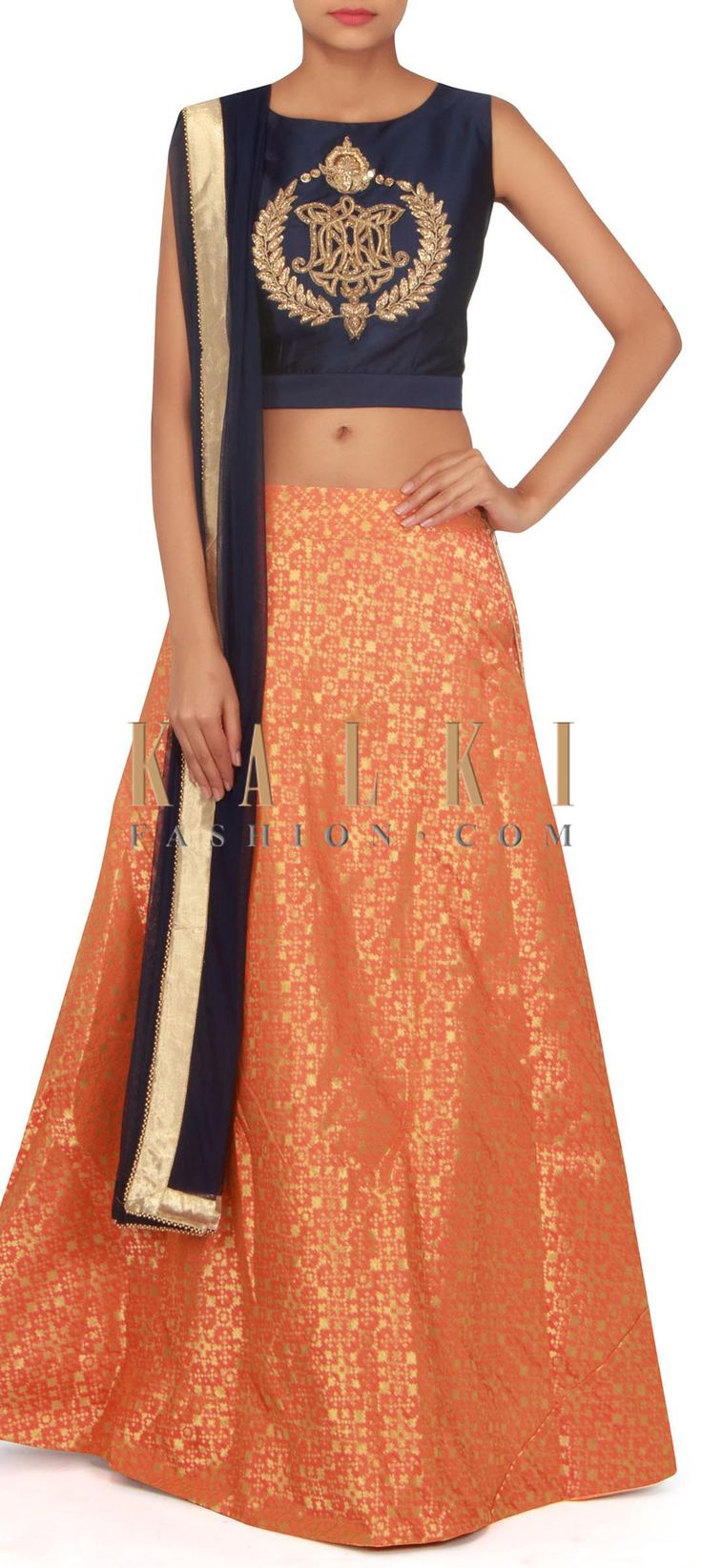 Orange lehenga in brocade with embroidered blouse only on Kalki