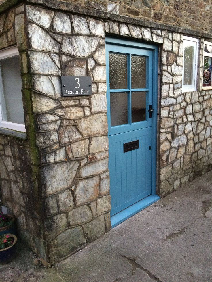 Our new front door, painted in Farrow and Ball's Stone Blue eggshell. Love it!