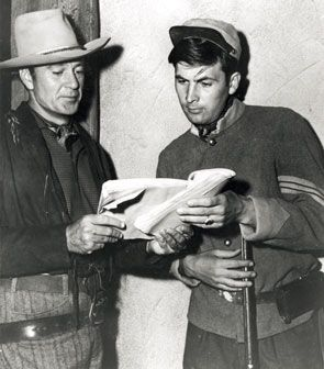 "Gary Cooper and Fess Parker study the script for ""Springfield Rifle"" ('52 Warner Bros.)."