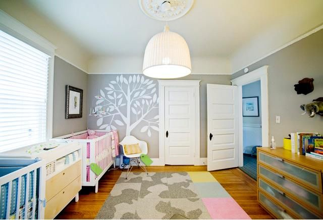 A gender neutral nursery for twins with a subtle tree and animal theme. #homedecor
