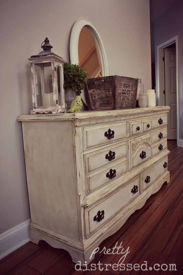 Goodwill Dresser Upcycle Reveal - This look was created using two coats of Annie Sloan Chalk Paint in Old White. I tried a new technique and distressed it before I used my Annie Sloan Clear Wax. I used 100 grit sand paper to distress followed by a coat of clear wax and finished it off with a mix of clear and dark wax. I wanted this really shabby because of all the nicks and dents it has, so I used dark wax on the entire piece versus just in the spots I distressed.