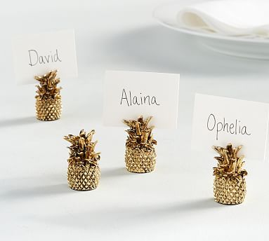 An antique-gold finish gives our Pineapple Place Card Holders a fun party look. They're perfect as tropical accents on a summertime table setting. KEY PRODUCT POINTS • Made of antique gold plated zinc alloy. • Imported. SET INFOR…