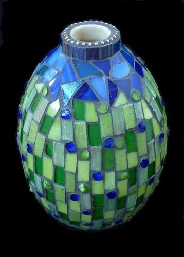 Small stuff I made for the market. Stained glass, glass tiles and rods, metal beads on ceramic vase.
