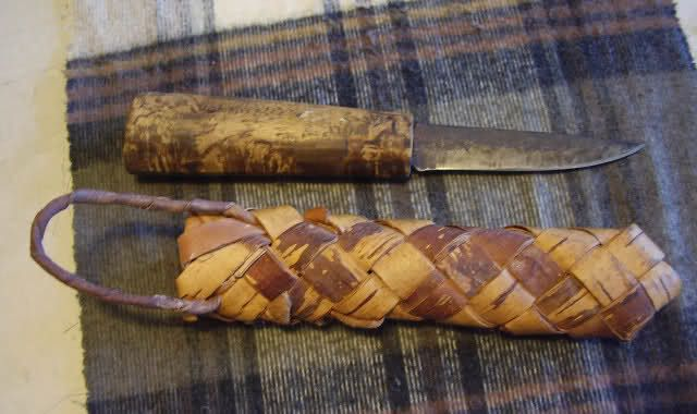 An old traditional Finnish puukko with its birch bark sheath.