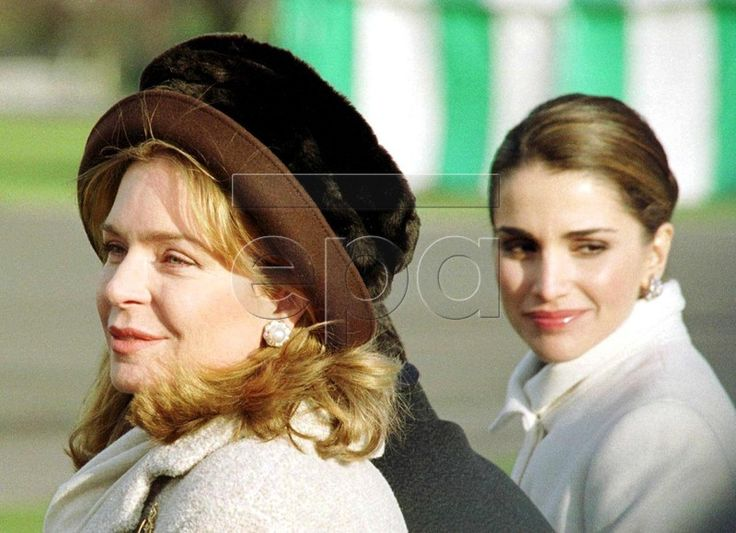 LON08 - 19991210 - LONDON, UNITED KINGDOM : The widow of the late King Hussein of Jordan Queen Noor (L) and Queen Rania, wife of King Abdullah II watch the 131st Sovereign's Parade at the Royal Military Academy Sandhurst, 10 December 1999, where the Crown Prince Hamzah received today the 'Overseas S