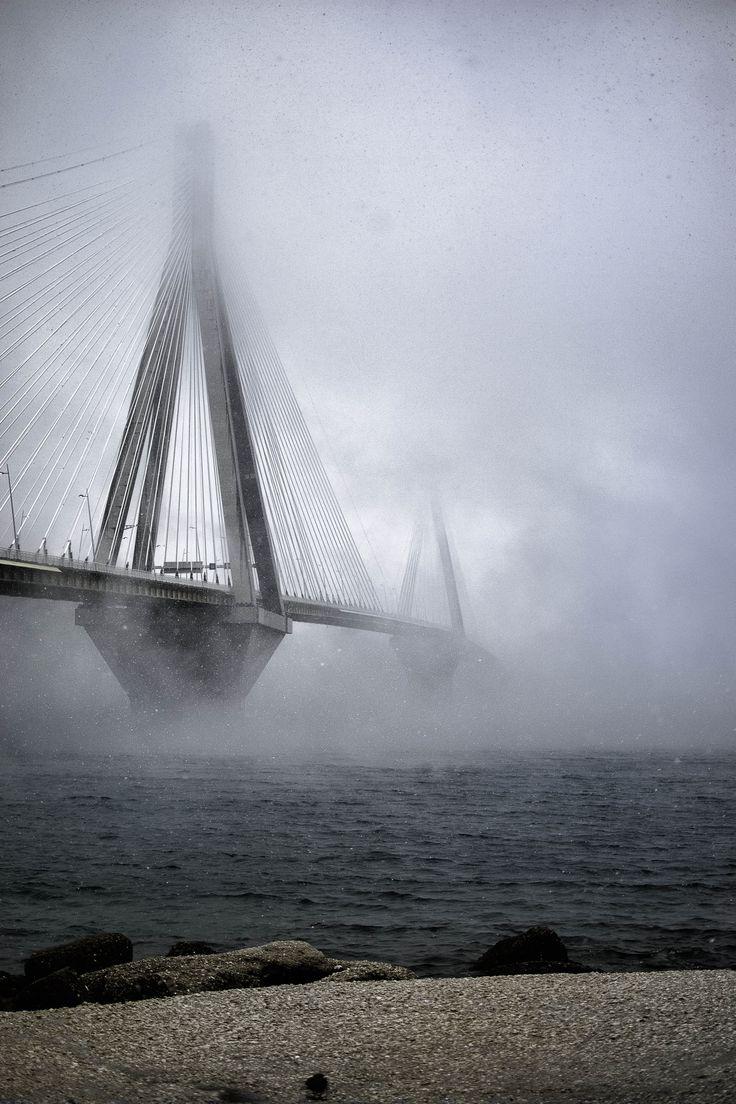 The Rio - Antirio Bridge with fog and snowfall, Patra, Greece | by Orestes Varesis