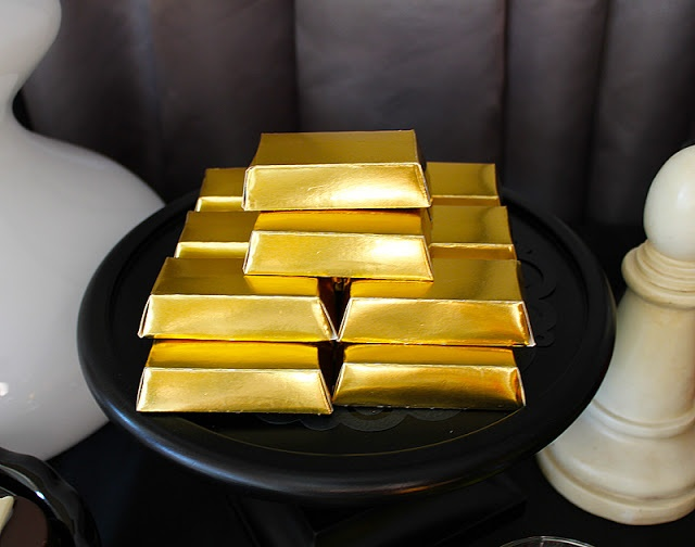 Gold nugget chocolates (preferably set up in open suit case) | Secret Agent 007 Spy Theme Party ideas games and decor
