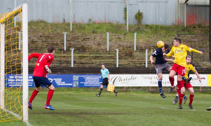 Queen's Park's Adam Cummins heads for goal during the SPFL League One game between Albion Rovers and Queen's Park.