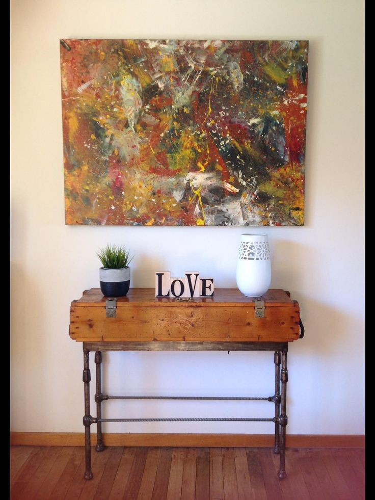 This sideboard was made by my husband. It's actually an old ammunition box which I banged up a with the nails and hammer. My hubby made the base by recycling an old antique bed head.  The canvas was actually a finger painting by two sons when they were both still in nappies.