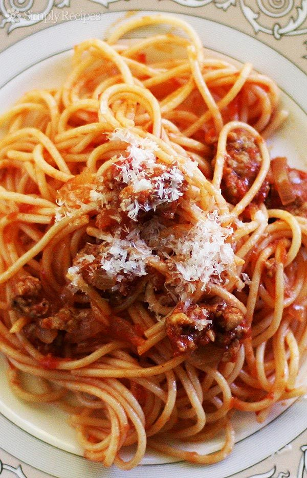 Italian Sausage Spaghetti ~ Quick and easy spaghetti recipe with Italian sausage.  The tomato-based sauce gets its seasoning from the sweet and spicy sausages.  Our favorite way of serving spaghetti. ~ SimplyRecipes.com