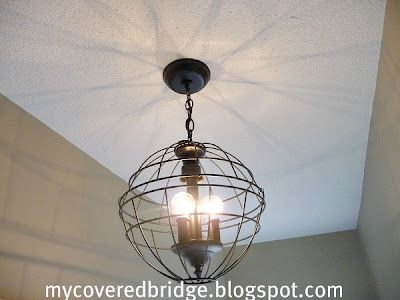 Fixture made with wire hanging baskets, are you kidding me?  Apparently not. Tutorial included.