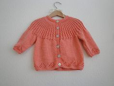 Cute vintage inspired baby cardigan with eyelet pattern and a circular yoke with eyelet rib. Free Ravelry pattern.