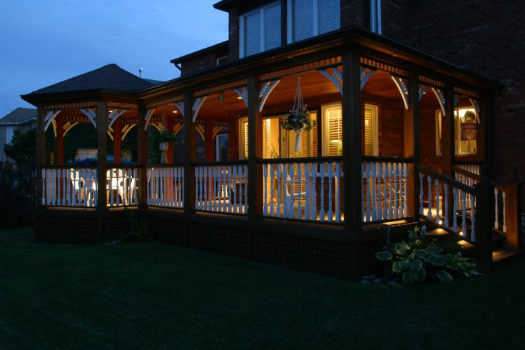This is a cedar back porch with a gazebo on one end. Built by Hickory Dickory Decks in Oakville Ontario.
