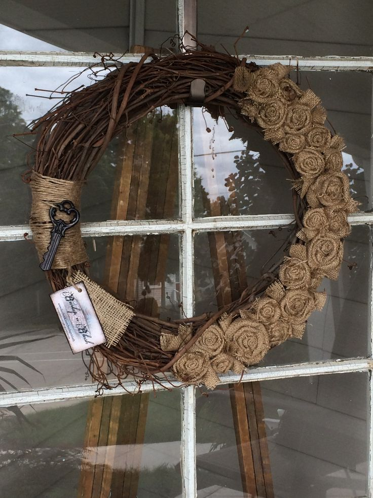 """18"""" Grapevine wreath adorned with natural burlap rosettes. #burlap #grapevine #wreath #fall"""
