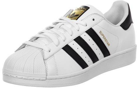 Le grand classique, la chaussure Adidas Superstar, vient ici dans la version enfant dans les petites tailles de 36 à 40 !- tige en cuir blanc - cheville rembourrée- pointe en caoutchouc blanc- semelle antidérapante en caoutchouc- bandes noires en simili cuir- talon noir avec logo imprimé- lettrage doré sur côtéTige : cuirDoublure : textile