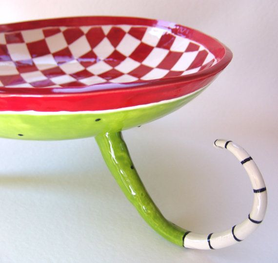 great big huge serving bowl -- red & white checkered on long curly  beetlejuice legs perfect for salad, pasta, fruit, or Watermelon!